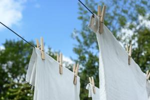 White linens hung up on clothes lines